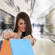 Stock Photo: Young womholding shopping bags