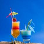 Fresh tropical cocktail on sunny beach — Stock Photo #41278163