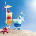 Fresh tropical cocktail on sunny beach — Stock Photo #41297955