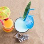 Fresh tropical cocktail on sunny beach — Stock Photo #41298401
