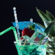 Stock Photo: Mint, strawberry and pineapple cocktail over black
