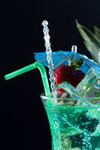 Mint, strawberry and pineapple cocktail over black — Stock Photo