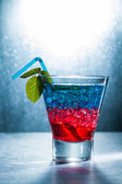 Layered cocktail with blue and red  — Stock Photo