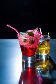 Strawberry cocktail and whiskey liqueur glass — Stock Photo