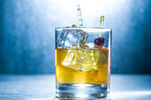 Whisky glass with ice cubes — Stock Photo