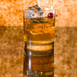 Stock Photo: Whisky liqueur glass with ice cubes
