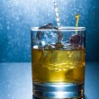 Stock Photo: Whisky glass with ice cubes