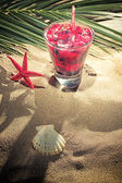 Raspberry cocktail on the sand  — Stock Photo