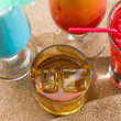 Fresh tropical cocktail on sunny beach — Stock Photo