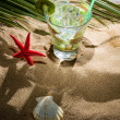 Stock Photo: Kiwi cocktail on sand