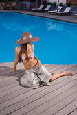 Young woman wearing a straw hat — Stock Photo