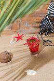 Fresh tropical cocktail on sunny beach — Stock Photo