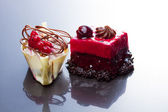 Chocolate, redcurrant and cherry cakes — Stock Photo
