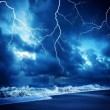 Lightning flashes across the beach durring the storm — Zdjęcie stockowe