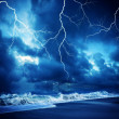 Lightning flashes across the beach durring the storm — Stock Photo