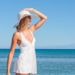 Women in the white on the sunny tropical beach — Stock Photo
