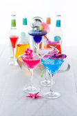 Blue swimming pool Cocktail with caviar and flower petals — Stock Photo