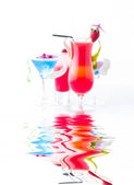 Fresh tropical layered cocktails — Stock Photo