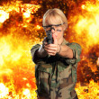 Hot blonde woman with gun over explosion — Stock Photo #45035833