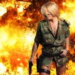 Hot blonde woman with gun over explosion — Stock Photo #45035997