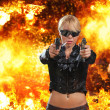 Hot blonde woman with gun over explosion — Stock Photo #45036121