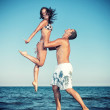 Happy young couple have fun on the beautiful beach — Stock Photo #45983131