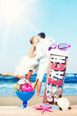 Icecream on the beach with young couple kissing  — Stock Photo