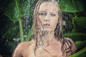 Woman in tropical shower — Stock Photo