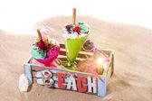 Two Icecreams in a box on the beach — Foto de Stock