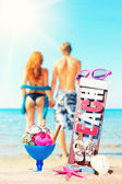 Icecream on the beach with young couple  — Stock Photo