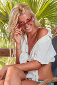 Woman relaxing at summer resort  — Stock Photo