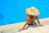 Young woman relaxing at the swimming pool  — Stock Photo
