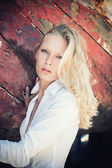 Woman portrait over wood background — Stockfoto
