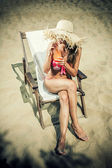 Young, slim and sexy woman on the beach — Stock Photo
