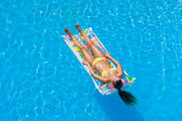 Young woman in the swimming pool — Stok fotoğraf