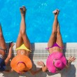 Girls  relaxing in a swimming pool — Stock Photo #47094237