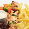 Постер, плакат: Chicken skewers with salad greens