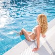 Blonde woman at the swimming pool — Stock Photo