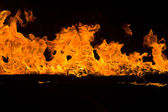 Blazing flames on black background — Стоковое фото