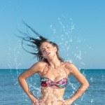 Beauty Model Girl Splashing Water in the ocean — Stock Photo #49107895