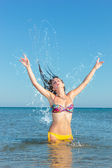Beauty Model Girl Splashing Water in the ocean — Stock Photo