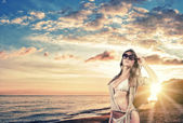 Portrait of a beautiful woman  on the beach — Stock Photo