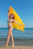 Woman in sarong on the beach — Stock Photo