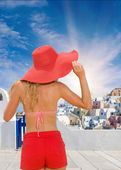 Young woman in red shorts in Santorini  — Stock Photo