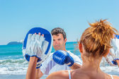 Couple training boxing on the beach — Stock Photo