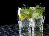 Green cocktail mojito on dark background.  — Stock Photo
