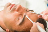 Man getting a face treatment  — Stock Photo