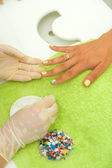 Woman getting a manicure  — Stock Photo