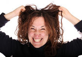 Young smiling tearing her hair — Stock Photo