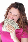 Young woman biting dollars by his teeth — Stock Photo